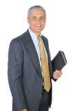 变老的生意人中间名笔记本 免版税图库摄影