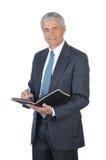 变老的生意人中间笔记本文字 库存图片