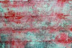 变老的绿色grunge油漆红色纹理墙壁 免版税图库摄影