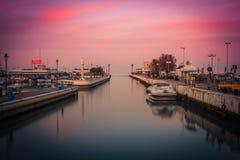 口岸的看法在日落的 长的曝光图片在里乔内,伊米莉亚罗马甘,意大利 免版税图库摄影