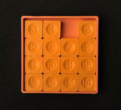口袋滑的十五个难题比赛桔子颜色 库存图片