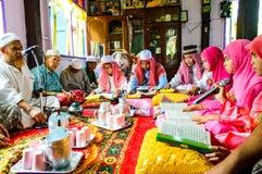 古兰经的毕业的仪式。 库存照片