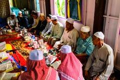 古兰经的毕业的仪式。 免版税库存图片
