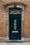 古典欧洲蓝色门在布鲁基 免版税库存照片