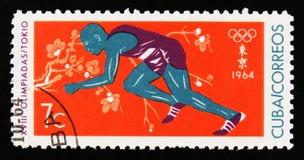 古巴在东京显示运动员赛跑者,第18次奥运会,大约1964年 免版税库存图片
