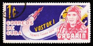 古巴显示加加林,苏联宇航员画象,有火箭的沃斯托克1,大约1963年 库存照片