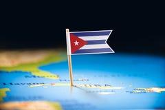 古巴标记用在地图的一面旗子 免版税库存图片