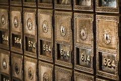 古板的邮政专用信箱行  免版税库存图片
