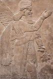 古老亚述人神飞过 免版税库存图片