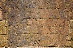 古老地板红土带石头背景 库存图片