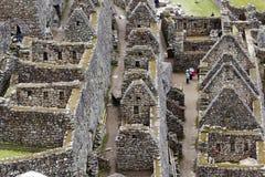 古老废墟的部分在马丘比丘的,秘鲁 免版税图库摄影