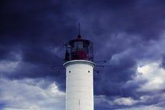 古老灯塔在海 免版税图库摄影
