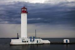 古老灯塔在海 免版税库存图片