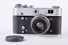 古老照相机和塑料盖帽 库存照片