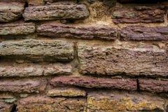古老石墙由长方形长方形形状做成石头  古老俄国堡垒墙壁, ` Oreshek `堡垒 在灰色红色或 免版税图库摄影