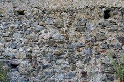 古老石清水墙背景在意大利 免版税库存图片