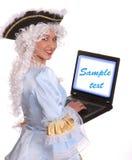 古老礼服膝上型计算机妇女 免版税图库摄影