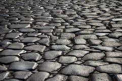 古老罗马大卵石石头路 免版税库存图片