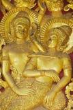 古老金黄外墙装饰的细节在Wat Xieng皮带佛教寺庙的在琅勃拉邦,老挝 库存照片