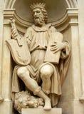 古老音乐家雕象 免版税库存图片