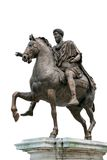 古老骑马查出的罗马雕象 免版税库存照片