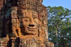 古老Bayon寺庙的面孔在暹粒市 图库摄影