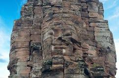 古老Bayon寺庙的面孔在吴哥窟,暹粒,柬埔寨的 免版税库存照片