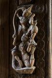 古色古香木雕刻以神的形式 免版税库存照片