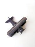 古色古香的双翼飞机设计玩具 免版税库存照片