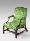 古色古香的在轻的背景的胳膊椅子浅绿色的室内装饰品 免版税图库摄影