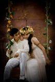 古色古香的夫妇穿戴纵向年轻人 免版税库存照片