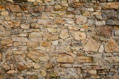 古色古香的小石墙背景 免版税库存图片