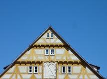 古色古香的时钟房子黄色 库存照片