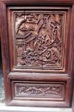 古色古香的木头被雕刻的盘区,中国 免版税库存图片
