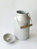 古色古香的水罐牛奶 库存图片