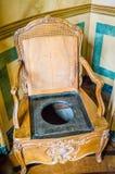 古色古香的洗手间椅子 库存图片
