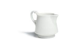 古色古香的瓷牛奶罐 库存照片