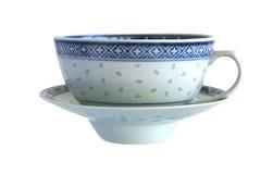 古色古香的瓷茶杯米五谷 免版税库存图片