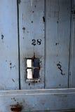 古色古香的监狱的细胞门 免版税图库摄影
