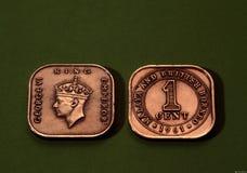 古色古香的硬币 库存图片