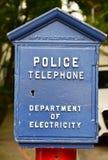 古色古香的蓝色框警察打电话 库存图片