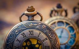 古色古香的被刻记的金属手表面孔 免版税图库摄影