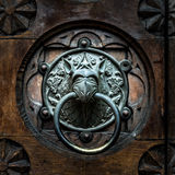古色古香的通道门环形状的monster& x27; s头 库存图片