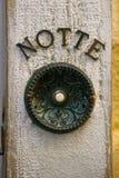 古色古香的门铃按钮 库存照片