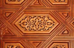 古董在阿尔罕布拉宫,西班牙雕刻了木装饰品 免版税库存图片