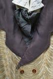 古董的细节,与一件花梢背心的西部样式人的衣服和领带 库存图片