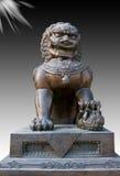 古铜色中国狮子雕象 图库摄影