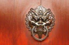 古铜色中国装饰狮子 免版税库存图片