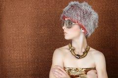 古铜色方式未来派金黄配置文件妇女 库存照片