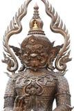 古铜色泰国在白色背景隔绝的样式巨人大雕象,一字符泰国文化小说的妖怪监护人 库存照片